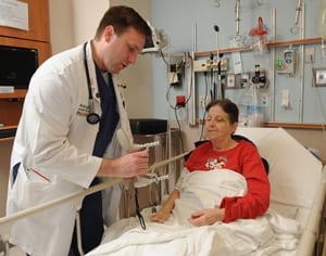 Chris Carpenter at an older patient's bedside