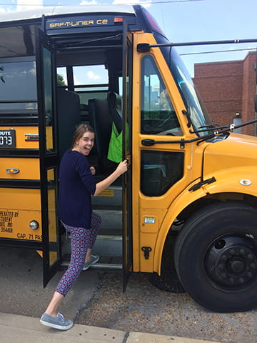 The yellow school bus with fellow Summer Research Program participant, Ali.