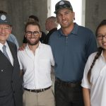 Photo of Chancellor Wrighton and students from Team WashU.