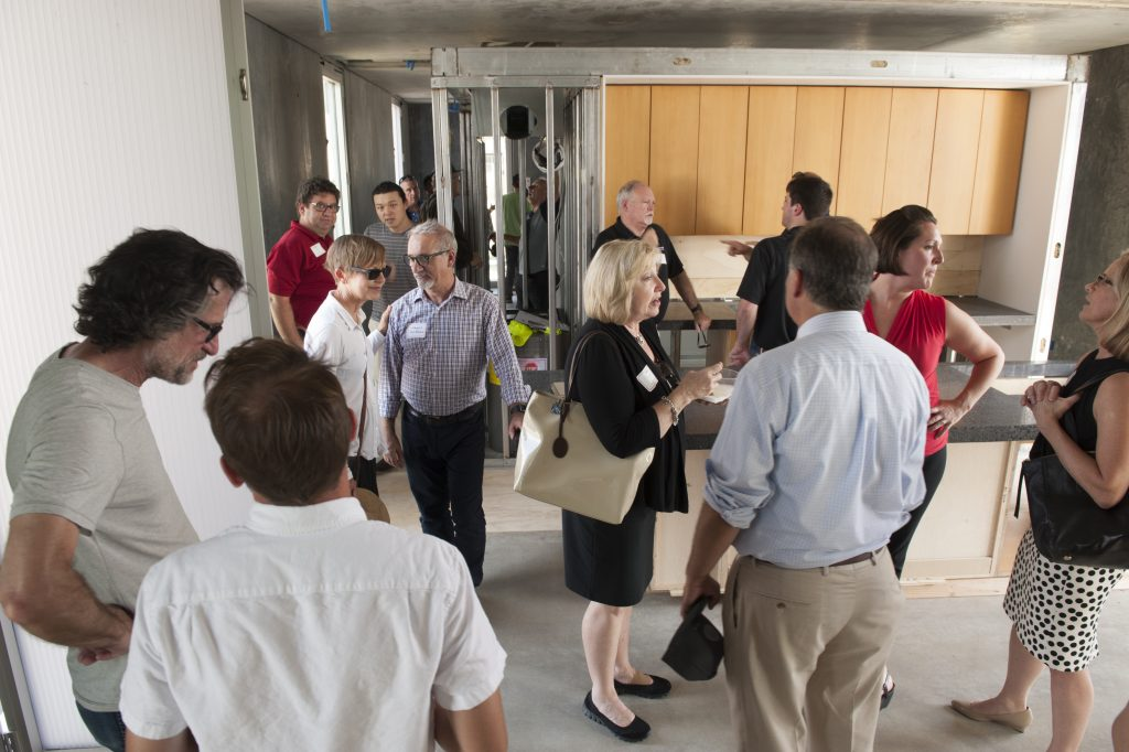 Attendees wander around the kitchen of CRETE House.