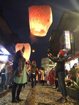 Letting go of our paper lantern during the Lantern Festival in Taiwan - thousands of lanterns were released that night in that area, and it's beautiful to see the synchronized release of hundreds at a time