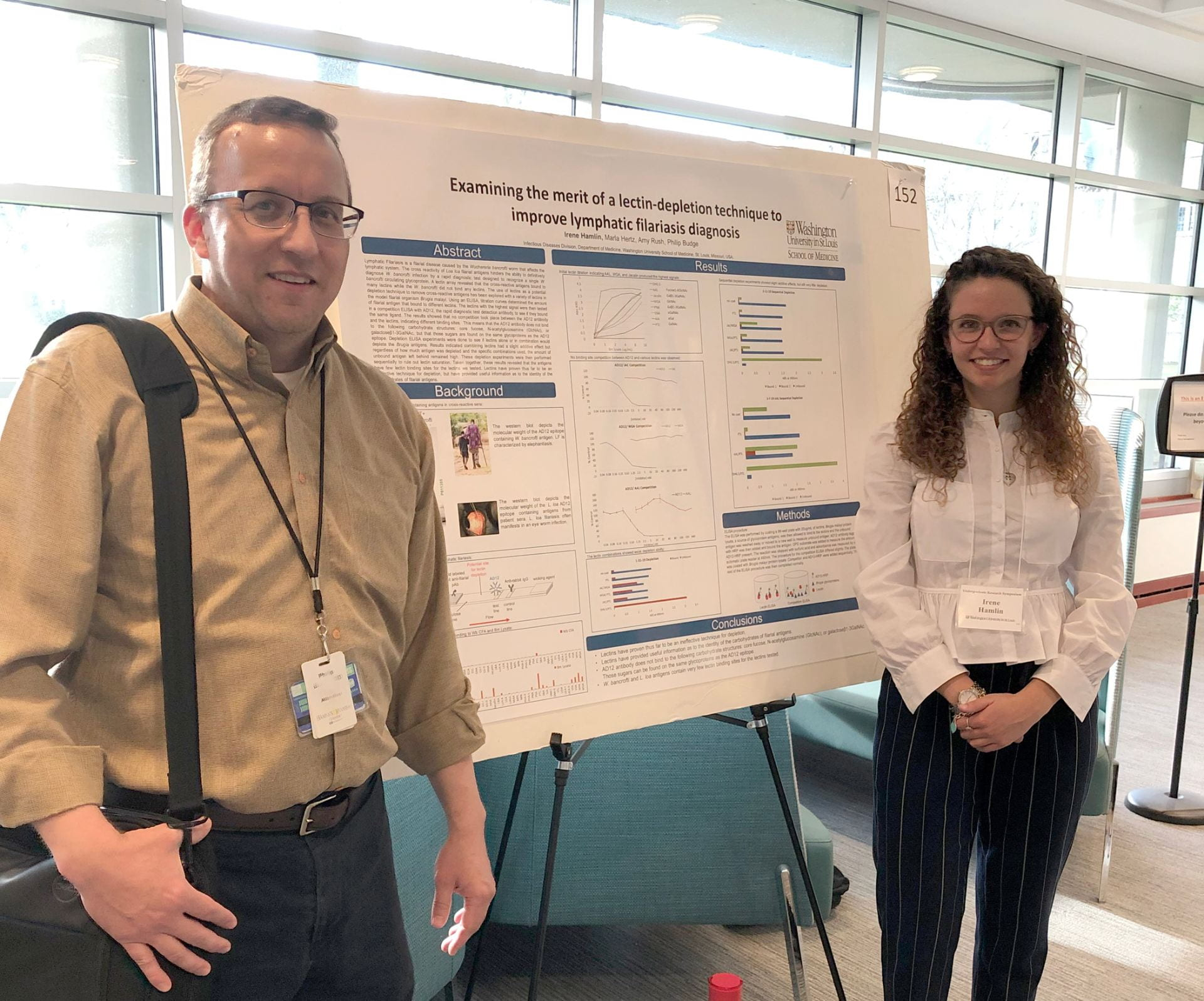 Mentor and undergrad with poster