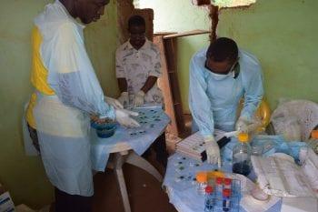 Preparation of Kato Katz slides for STH detection in Liberia.