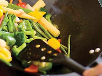 Chef prepares stir fry