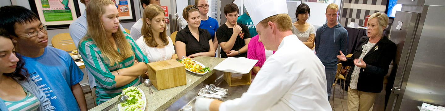 Students watch a chef's demonstration at Studio 40