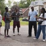 Students from Washington University in St. Louis toured Lewis Place, a historic African-American neighborhood in St. Louis, Saturday, Aug. 29, 2015 as part of WUSTL's 2015-16 Meet St. Louis program. Pamela Talley, a Lewis Place resident and president of Lewis Place Historic Preservation, Inc., led the tour. Students also volunteered in the groups' Lewis Place Community Garden. Lewis Place resident Kevin Jones describes the neighborhood during the tour.  Photo by Sid Hastings / WUSTL Photos