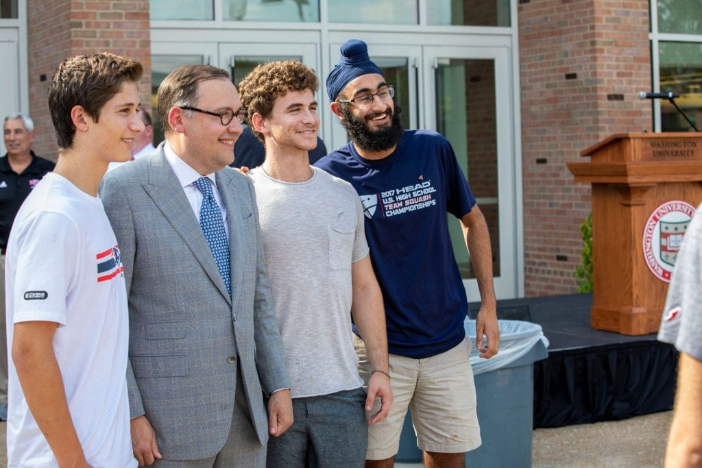 Chancellor Andrew D. Martin poses with WashU students