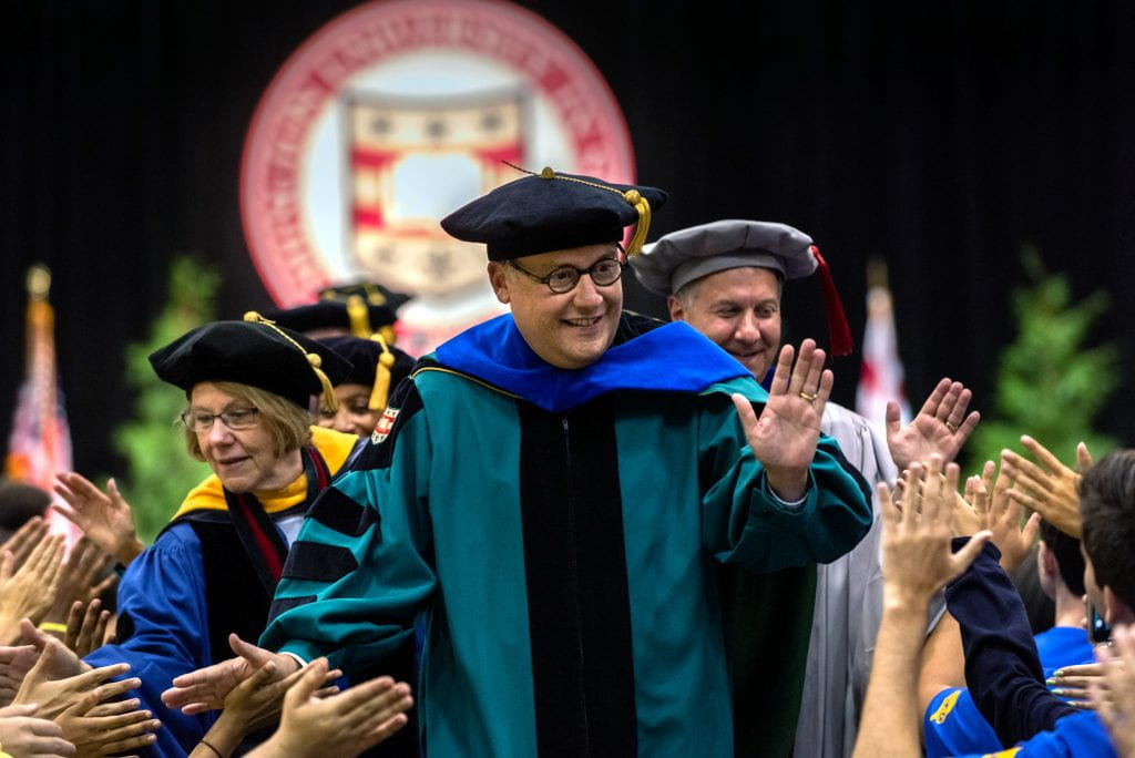 Chancellor Andrew D. Martin (center), joins Barbara Schaal (left), Dean of the Faculty of Arts & Sciences and Aaron Bobick, Dean of the McKelvey School of Engineering, in greeting students during the recessional at the conclusion of Convocation.