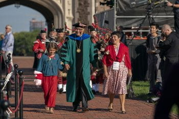 Andrew D. Martin walking through the Brookings Quad with Stephanie and Olive Martin