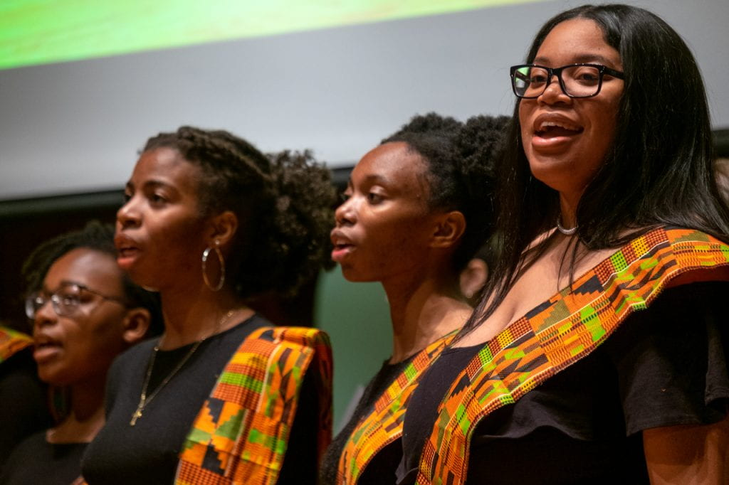 Three students singing
