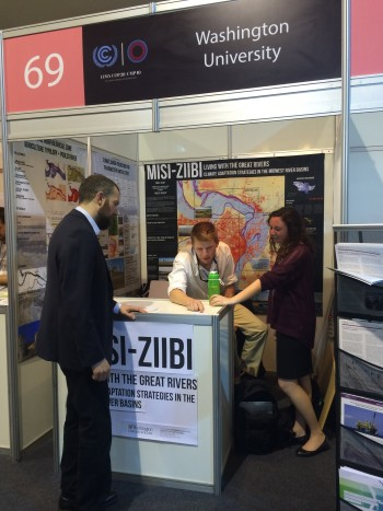 Students man the MISI-ZIIBI project booth, showcasing the work of Professors Hoal and Hoeferlin on climate adaptation strategies for the great rivers.
