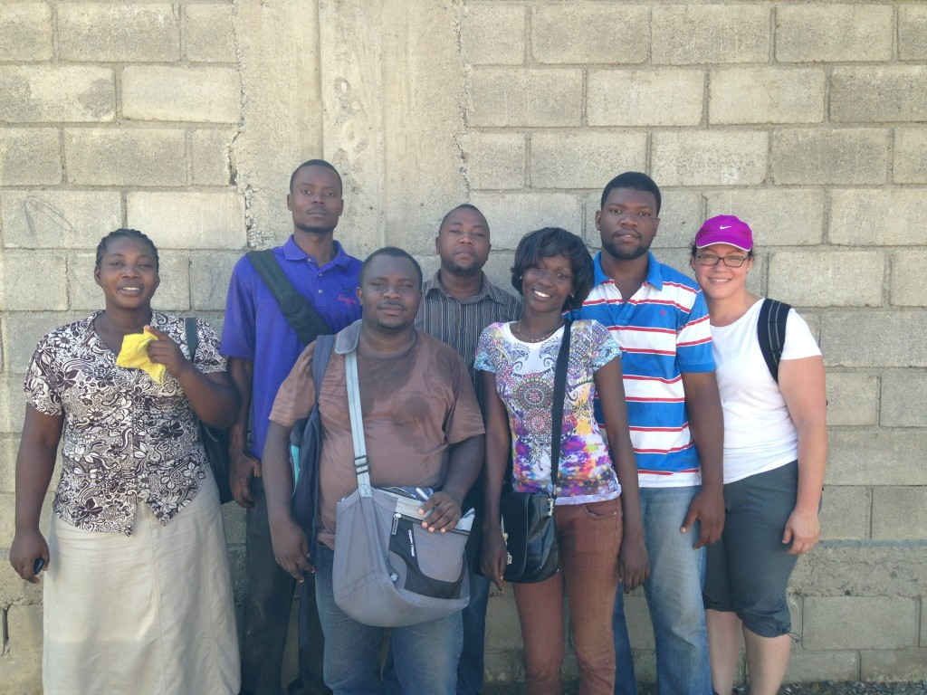 Zorimar Rivera-Núñez (right) poses with her research team on the ground in Cap-Haitien, Haiti, which includes a community health worker and students from the Université Publique du Nord au Cap Haïtien.