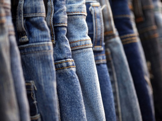 Photo of blue jeans of different colors.