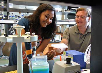 Biology Professor Joseph Jez (right) and Suchismita Roy work in Jez's lab.