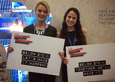 Washington University students Taylor Blevin and Talia Rubnitz advocating for a low limit on carbon emissions at COP21 in Paris.