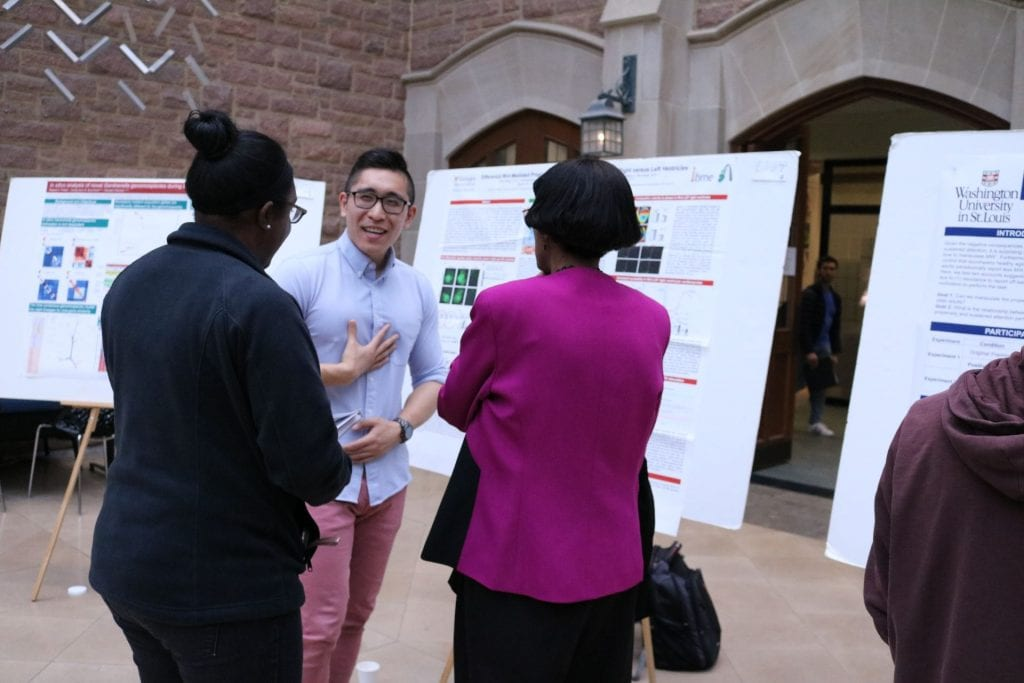 Biomedical Engineering student Rich Li explains their research to judges