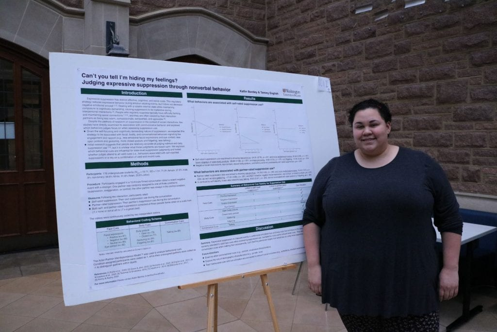 Psychological & Brain Sciences student Katlin Bentley poses next to their poster