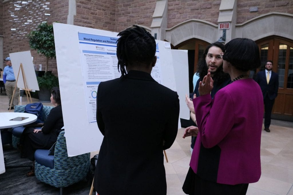 Psychological & Brain Sciences student Isidro Landa explains their research to judges