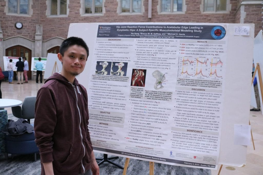 Engineering student Ke Song poses next to their poster