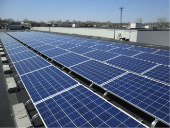A photovoltaic array lines the roof of a building on WashU Campus.