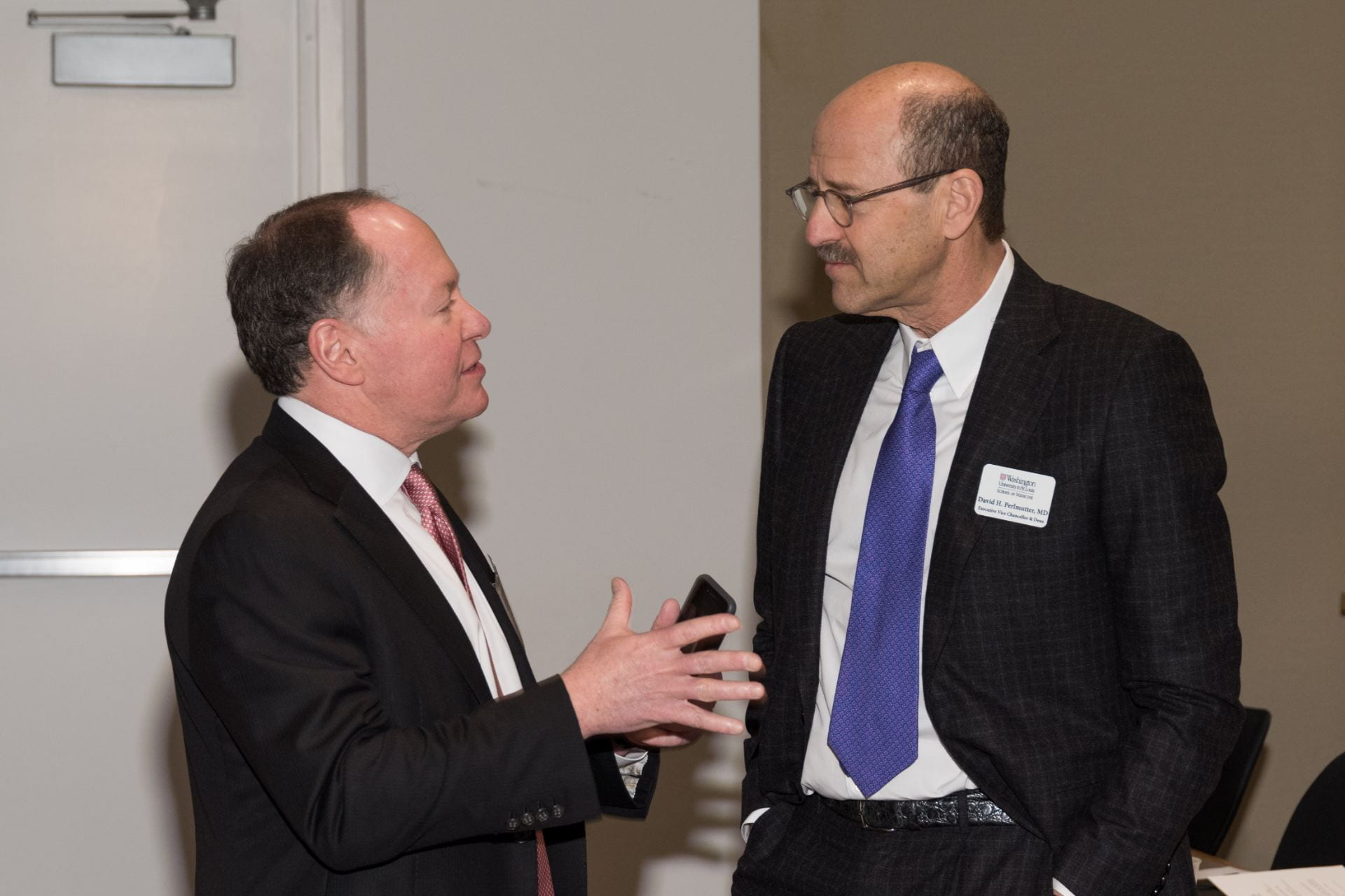 Mr. Andrew Bursky and Dean David Perlmutter confer before the symposium.