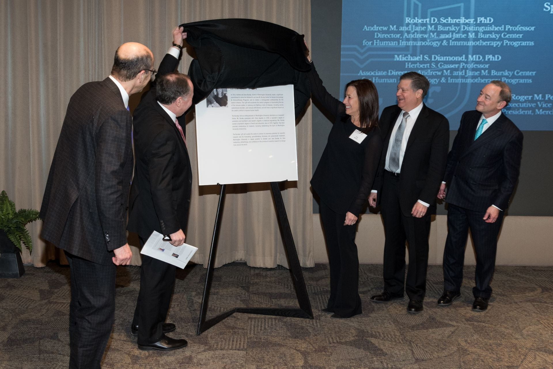 Unveiling of the plaque honoring the creation of the Bursky Center. Dean Perlmutter, Andy Bursky, Jane Bursky, Bob Schreiber and Chancellor Wrighton (left to right).