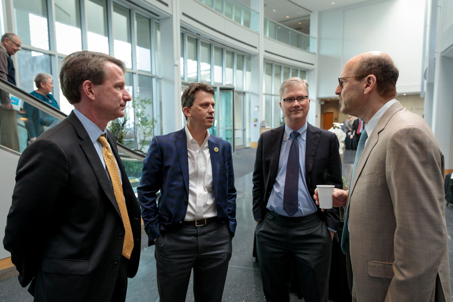 """NCI Director Norman E. """"Ned"""" Sharpless, MD, Clay Thorp, Provost Holden Thorp and Dean David Perlmutter"""