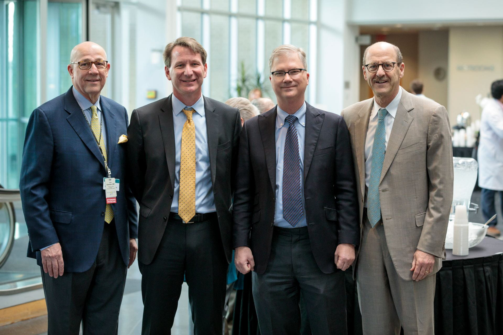 """Timothy Eberlein, MD, Director of Siteman Cancer Center, left, NCI Director Norman E. """"Ned"""" Sharpless, MD, Provost Holden Thorp, and Dean David Perlmutter"""