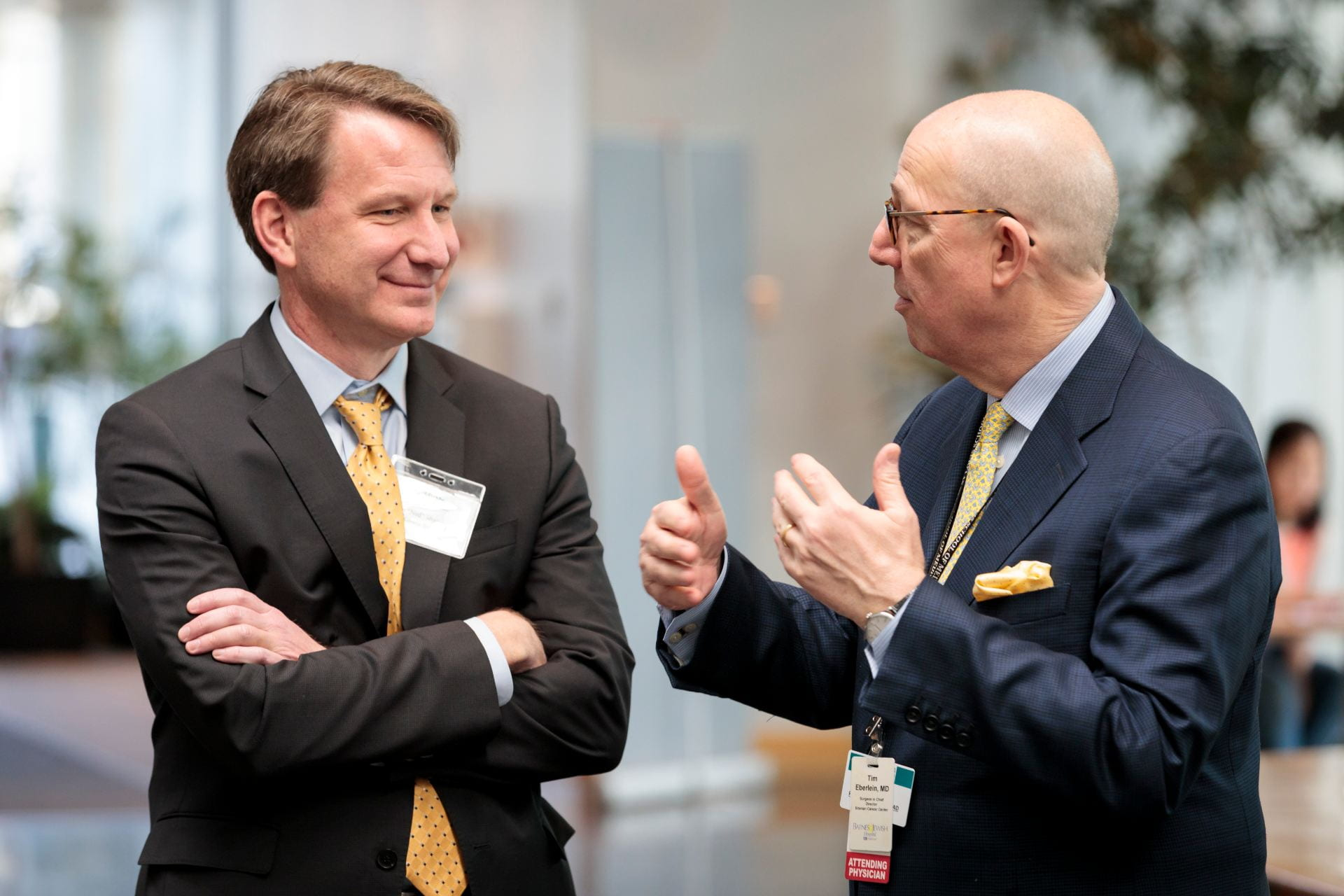 """NCI Director Norman E. """"Ned"""" Sharpless, MD, left, talks with Siteman Cancer Center Director Timothy Eberlein, MD, before the The Burksy Center at Washington University 2nd Annual Symposium"""