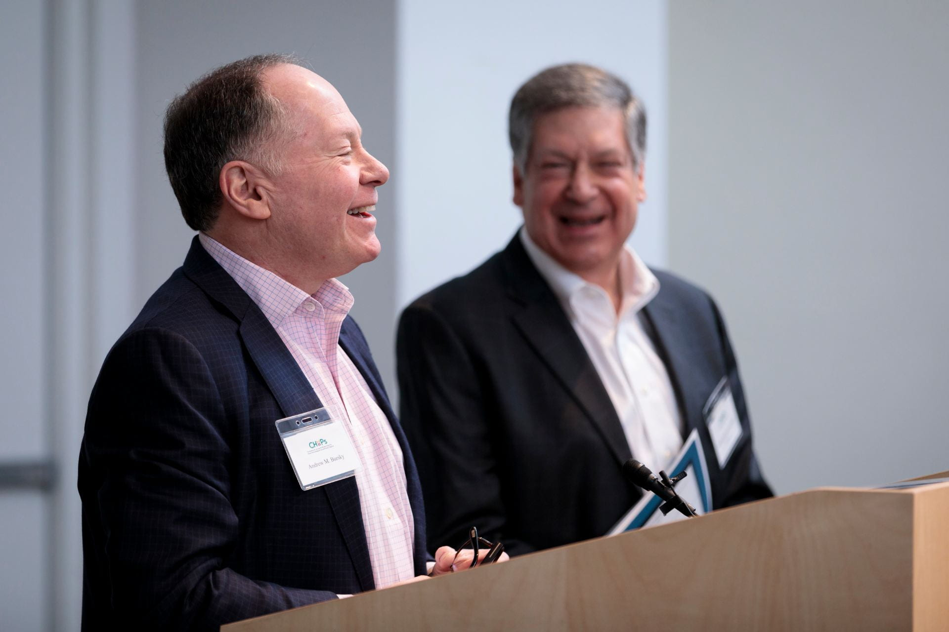 Andrew Bursky, left, and Robert Schreiber, PhD, enjoy a moment during the welcome to The Burksy Center at Washington University 2nd Annual Symposium