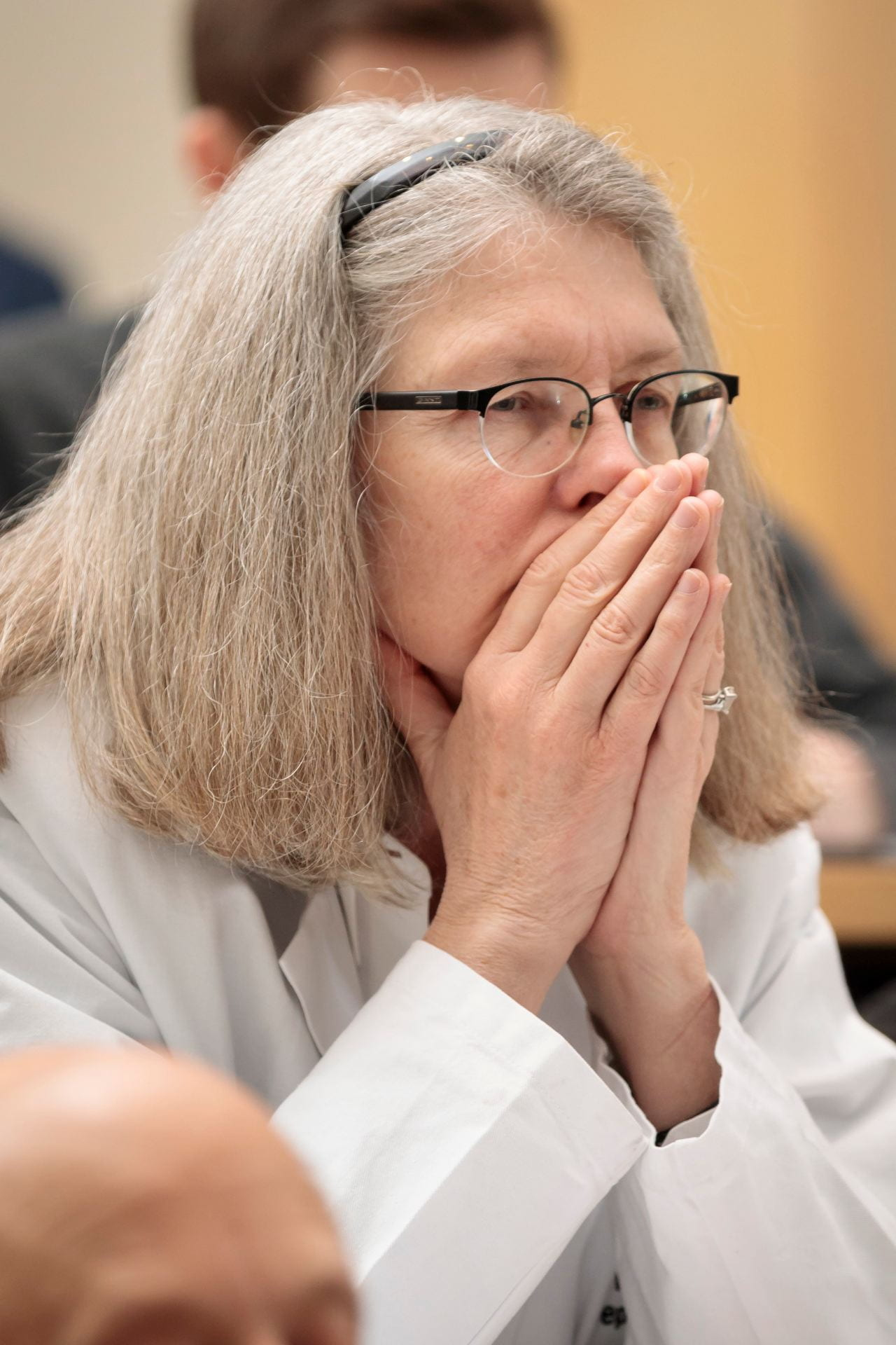 Vicky Fraser, MD, head of the Department of Medicine, listens to the lectures