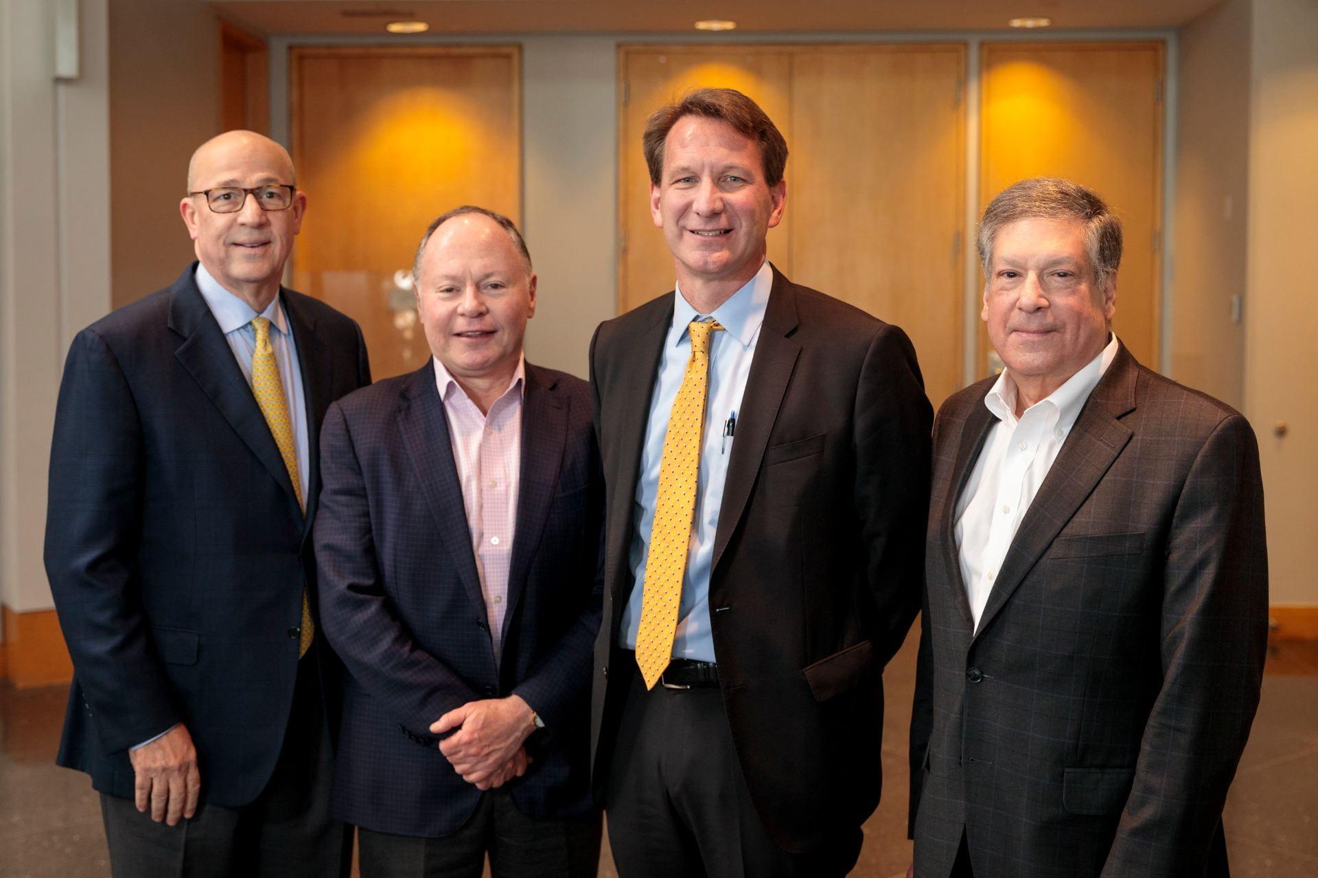 """Siteman Cancer Center Director Timothy Eberlein, left, Andrew Bursky, NCI Director Norman E. """"Ned"""" Sharpless, MD, and Robert Schreiber, PhD"""