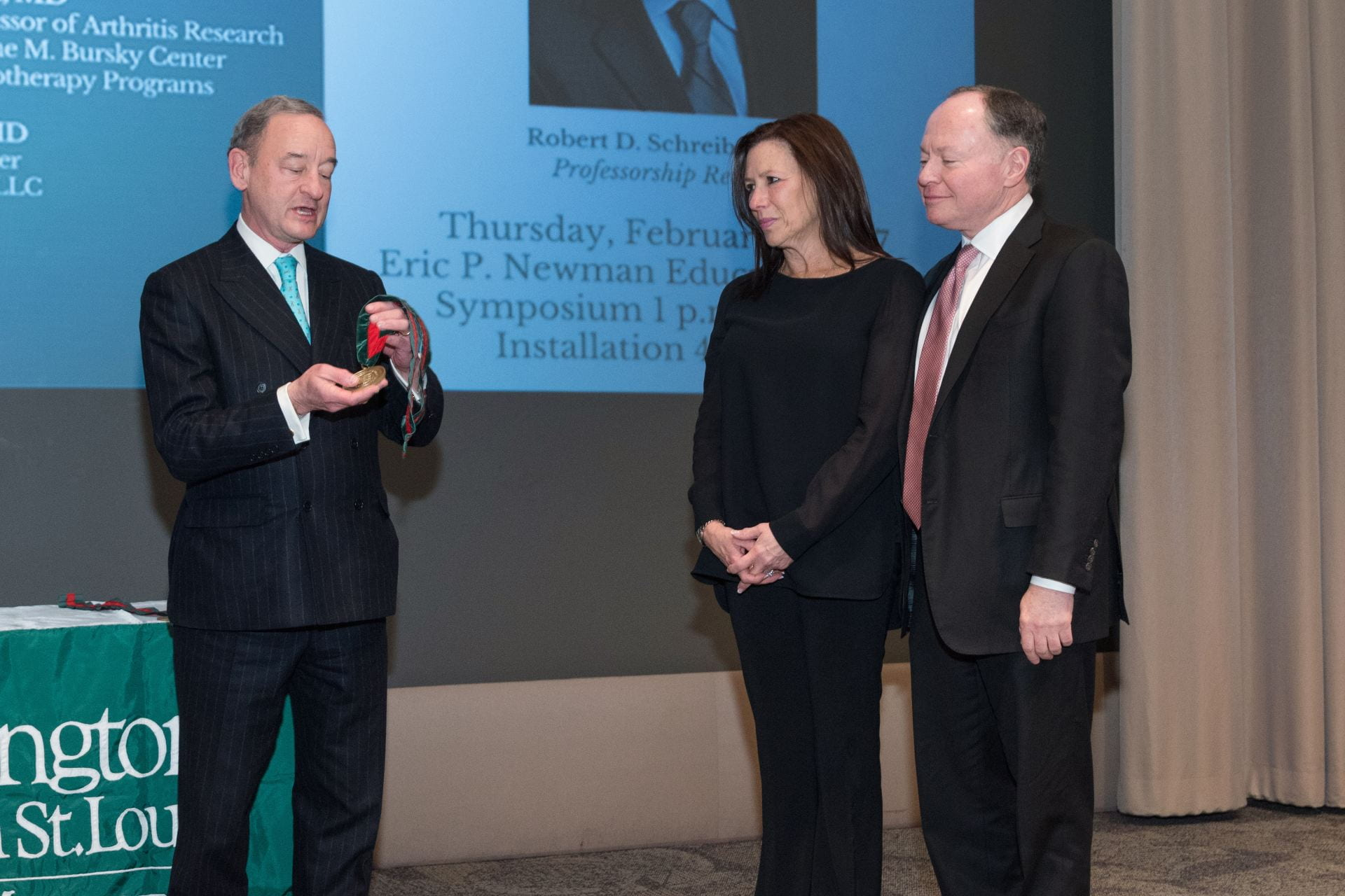 Chancellor Wrighton presents Mr. & Mrs. Bursky with their medallions during the Andrew M. and Jane M. Bursky Distinguished Professorship Installation Ceremony.