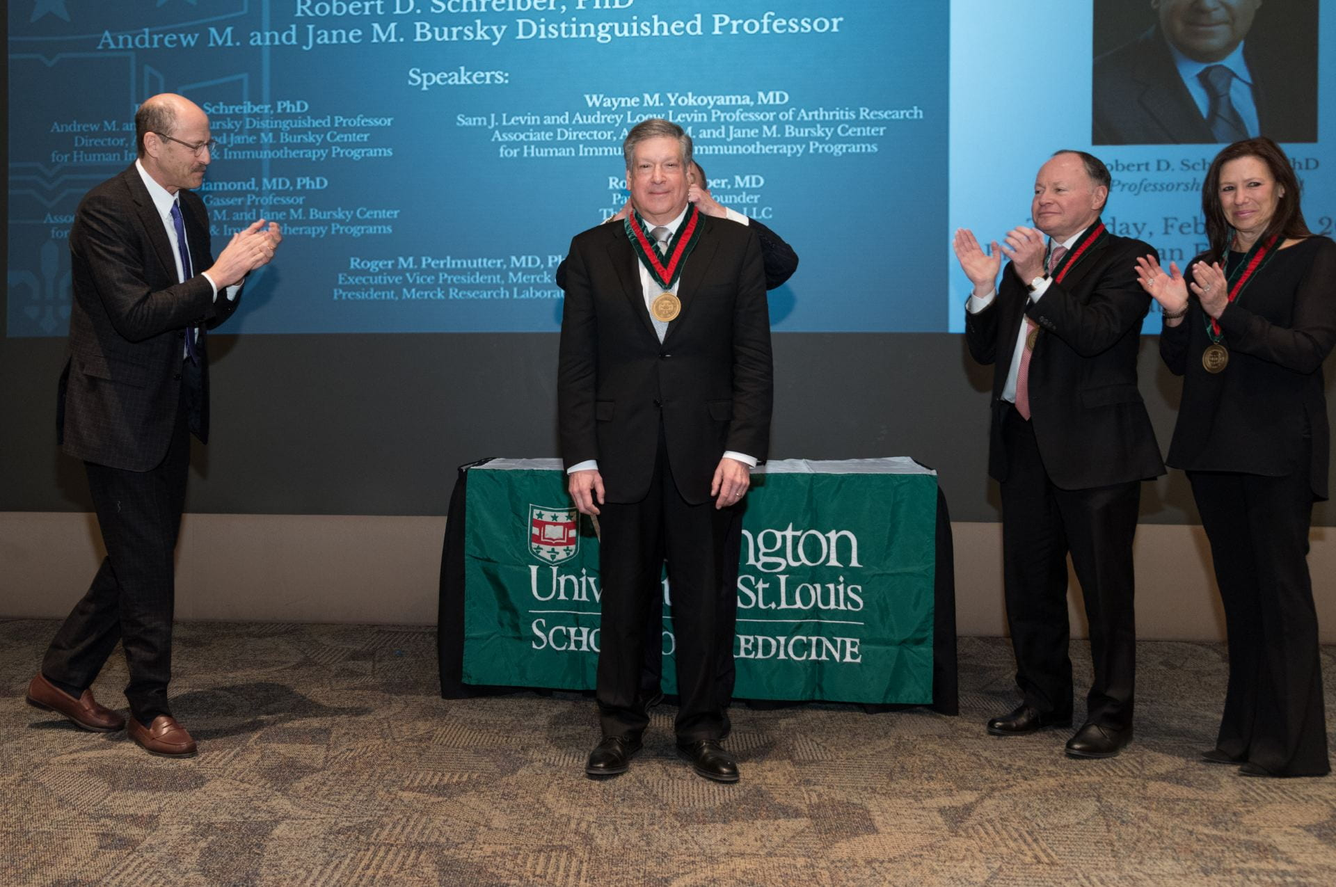 Chancellor Wrighton bestows upon Dr. Robert D. Schreiber the Andrew M. and Jane M. Bursky Distinguished Professor medallion.