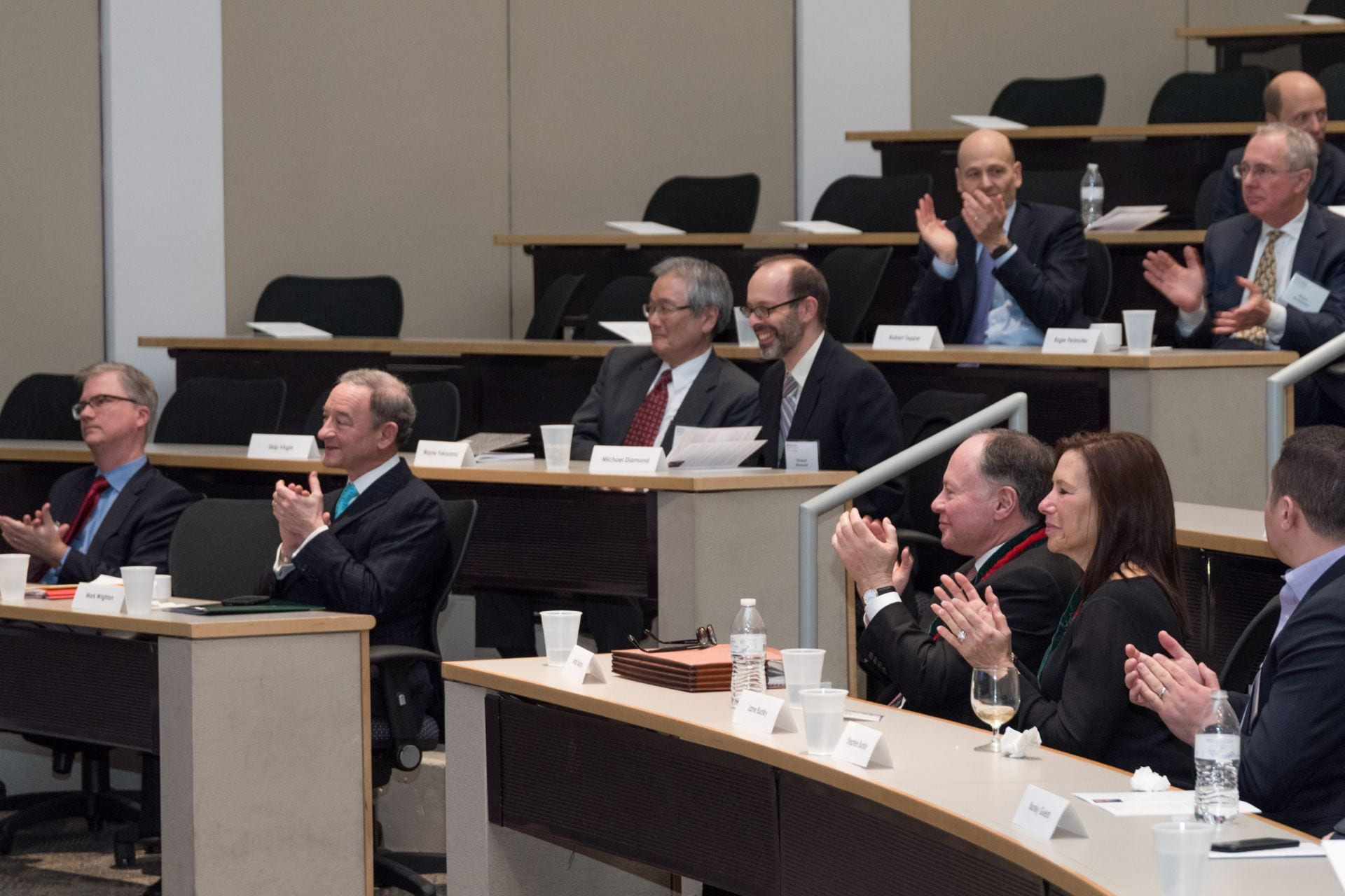 Distinguished guests applaud Dr. Schreiber's presentation on novel advances in cancer immunotherapy.