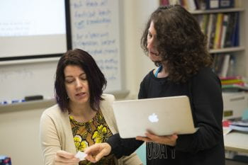 MySci's Engineering Educator Kimberly Weaver (left) collaborates with Ferguson Florissant teacher Lisa Baker (right) on the development of a new middle school science curriculum, made possible by a $1.9 million grant from the Monsanto Fund. (Photo by Joe Angeles/WUSTL Photos)