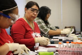 How hot is hot? Yolanda Barrera (center) conducts a science experiment using a variety of peppers.