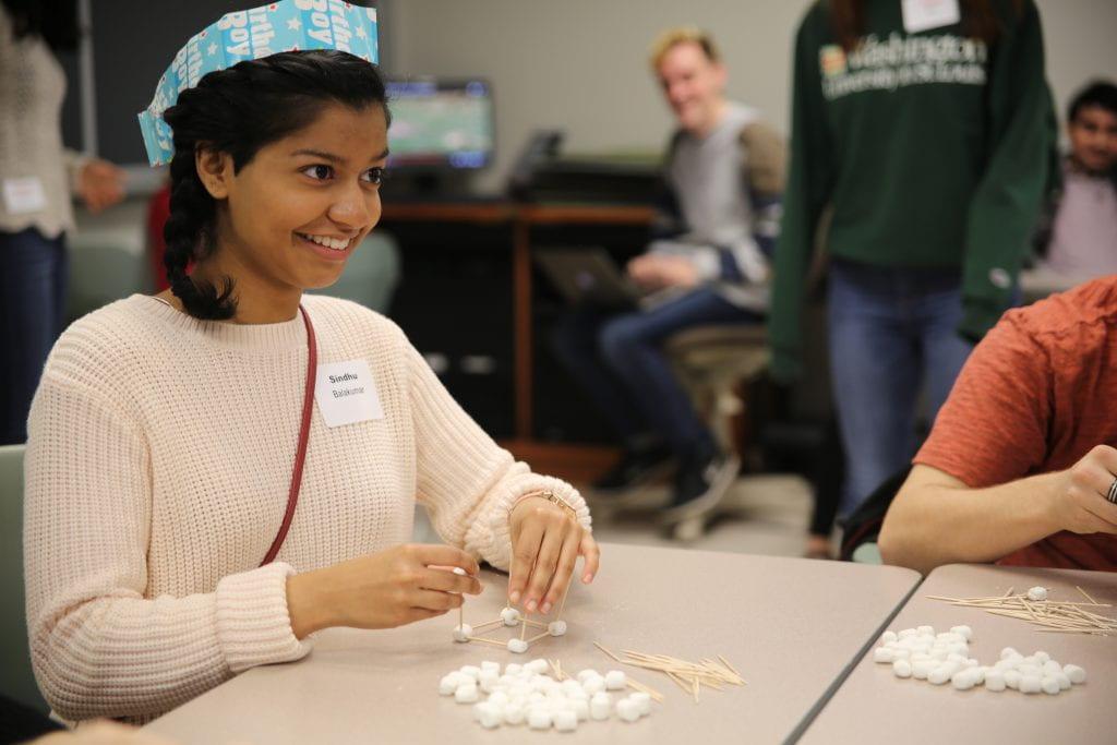 Undergrads teach, inspire high school students