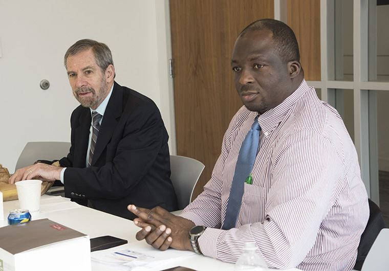 Dr. Adetunji Toriola (right) meets with a work group with acting NCI director, Dr. Doug Lowy (left).