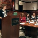 WSWU member introduces the panelists at the 2011 Composing a Life event