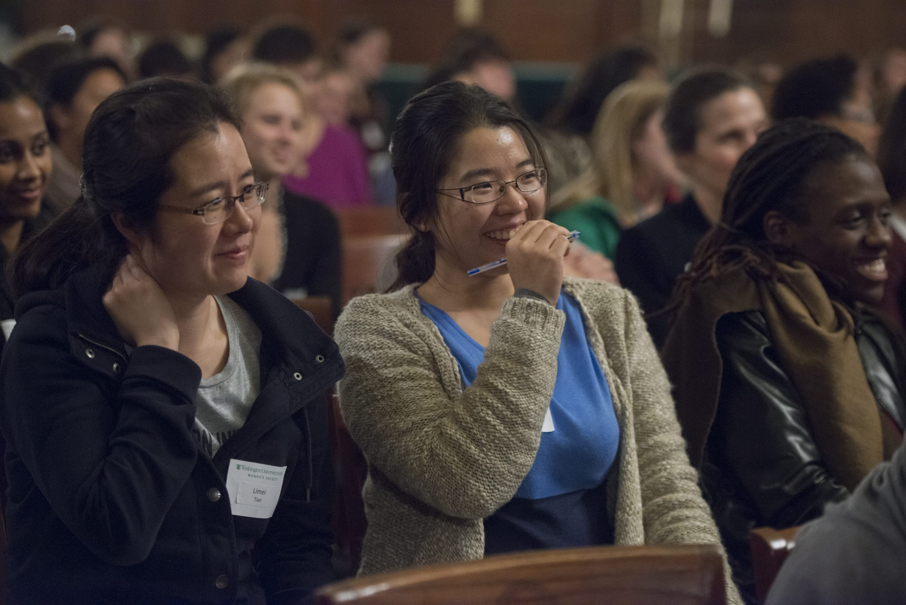 An audience member laughs at a comment at the 2013 WSWU Composing a Life event