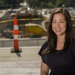 Jane Kojima stand in front of the Washington University East End Transformation construction site.
