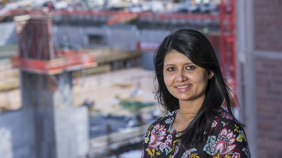 WashU's Railesha Tiwari stands in front of the East End construction site on the Danforth Campus.