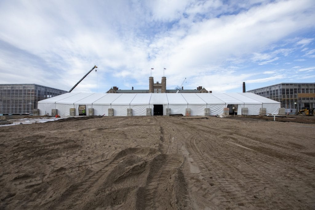 Large white construction tent on the campus of Washington University in St. Louis