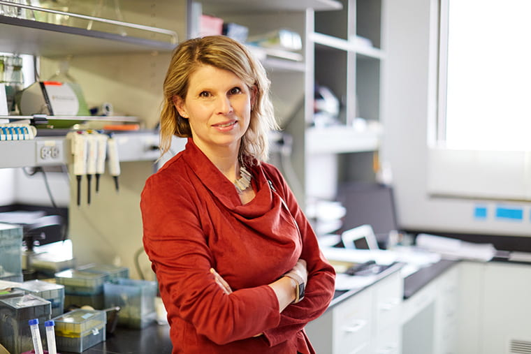 Valeria Cavalli works in her neuroscience lab with her staff on February 12, 2020