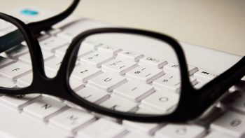 glasses resting on a computer keyboard