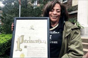 Gena Gunn McClendon holds the mayoral proclamation declaring May 8 the John Lewis Voting Advancement Action Day in St. Louis.