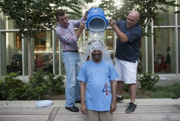 In 2014, Olin Business School Dean Mahendra Gupta completes the ALS Ice Bucket Challenge at the annual Welcome Back Cookout, after being challenged by Washington University in St. Louis Provost Holden Thorp.