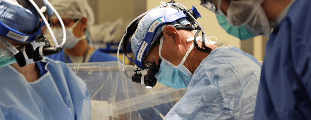 Marc Moon, MD, Section Chief of Cardiac Surgery at Washington University School of Medicine and President of the American Association for Thoracic Surgery, operating in the OR alongside the CT surgery team.