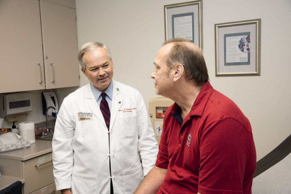 Dr. Chapman with patient in clinic